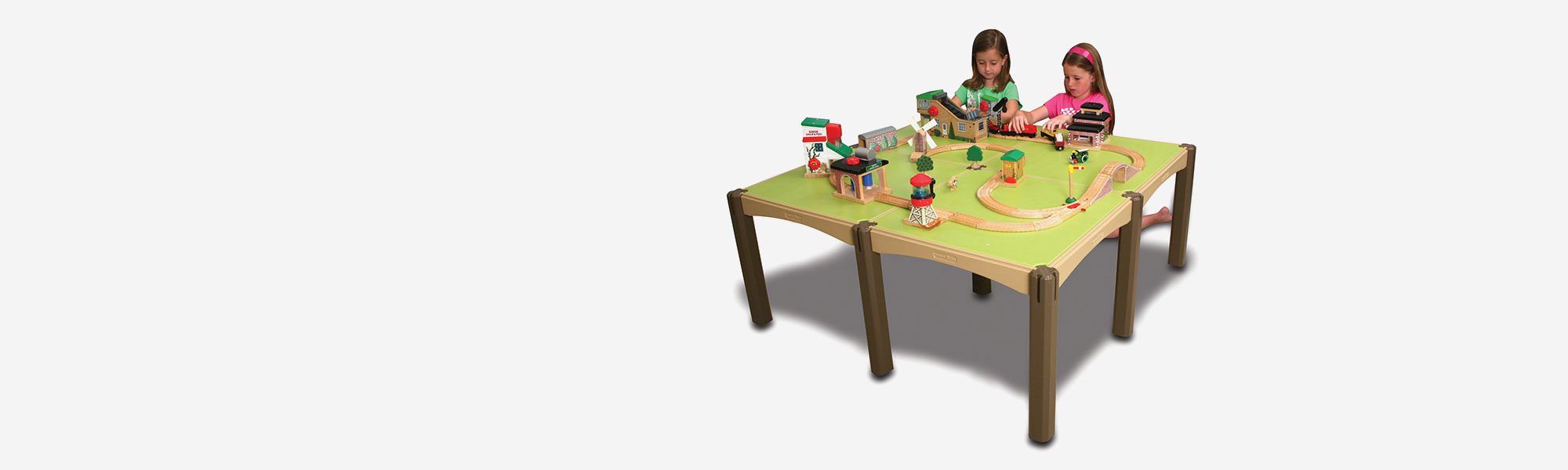 Children Using a Kids' Modular Activity Table with Train Set